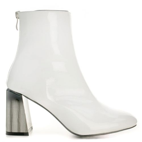 White bootie with black and white heel