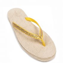Women's yellow textile flip flops